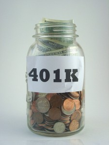 Jar filled with pennies, nickles, dimes, and dollar bills, labeled 401k.